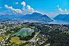 Foto 149: Der Lago di Muzzano mit Lugano TI im Hintergrund.
